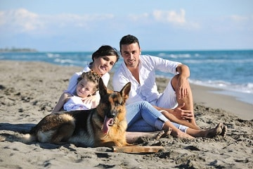 Family on beach with dog SVK