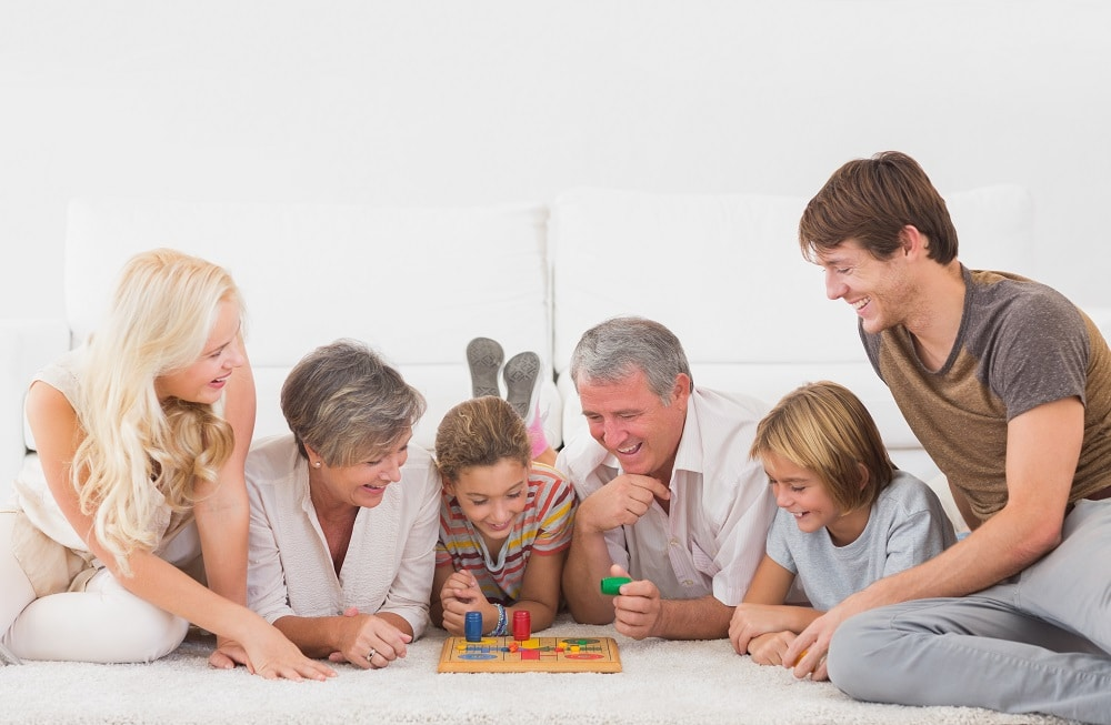 family enjoying playing fun financial board games for kids